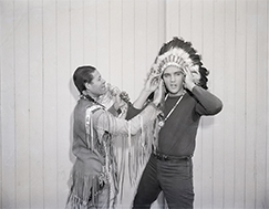 Elvis Presley receives a headdress, 1960
