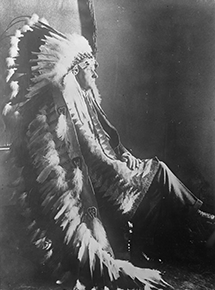 President Coolidge wears an eagle-feather headdress, 1927