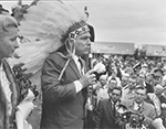 Jimmy Hoffa wears an eagle-feather headdress, 1959